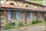 A vendre par TAIC-Immobilier secteur Lavaur Propriété 150m2 sur 1,7 hectare avec boxes, carrière, dépendances.