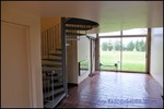 A vendre par TAIC Immobilier à Castres Grande longère de 1000m2 sur 8900m2 de terrain comprenant partie privative, 7 studios et dépendances,puit,lavoir.